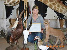 Dina with her trophies after her six week taxidermy course in 2010